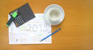 Business plan for 2018, start up scribble,. Business plan for 2018, start up strategy scribble, flat lay, free copy space Royalty Free Stock Photos