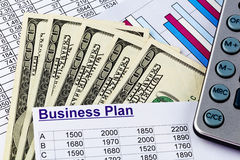 Business plan. A business plan for starting a business. ideas and strategies for self-employment. dollars and calculator Stock Photos