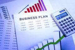 Business plan with tables and charts royalty free stock images