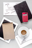 Business plan with tablet and copybook gray table background top view mockup Royalty Free Stock Photography