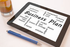 Business Plan. Text concept on a mobile tablet computer on a desk - 3d render illustration Royalty Free Stock Image