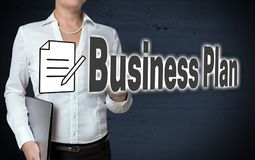 Business plan touchscreen is shown by businesswoman stock image