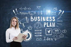 Business plan and a woman with notebook Stock Photo