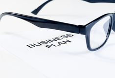 Business plan words near glasses, business concept Stock Images