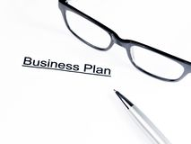Business plan words near glasses and pen, business concept Royalty Free Stock Photos