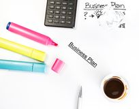Business plan words near highlighters, calculator and cup of coffee, business concept Royalty Free Stock Photography