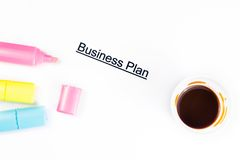 Business plan words near highlighters and cup of coffee, business concept Royalty Free Stock Photo