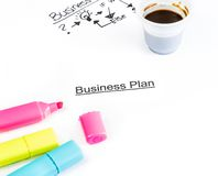 Business plan words near highlighters and cup of coffee, business concept Royalty Free Stock Images