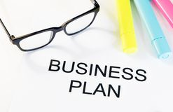 Business plan words near highlighters and glasses, business concept Stock Photos