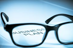 Business plan words see through glasses lens, business concept Royalty Free Stock Photos