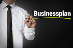 Business Plan is written by businessman background concept stock photos