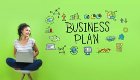 Business plan with young woman. Using a laptop computer stock image