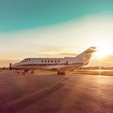 Business plane at airport with sun rays Stock Photography