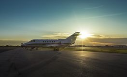 Business plane at airport at sunset Royalty Free Stock Photography