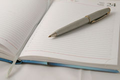 Business planner. Opened business planner with pen Royalty Free Stock Photos