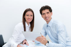 Business planning. Businessman and businesswoman at the workplace planning with digital tablet Stock Photography