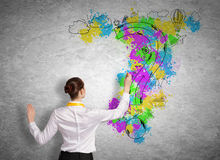 Business planning. Back view of businesswoman drawing business ideas on wall Royalty Free Stock Photos