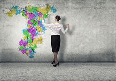 Business planning. Back view of businesswoman drawing business ideas on wall Stock Photo