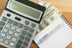 Business planning, calculator, money and notebook Stock Photo