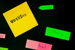 Close-up of colorful notes On a black background royalty free stock photography