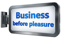 Business before pleasure on billboard. Business before pleasure wall light box billboard background , isolated on white Royalty Free Stock Photo