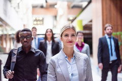 Business poeple group. Young multi ethnic business people group walking standing and top view Royalty Free Stock Photos