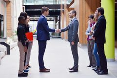 Business poeple group. Young multi ethnic business people group walking standing and top view Stock Images