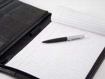 Business Portfolio. A pen and pad of paper inside a business portofolio stock image