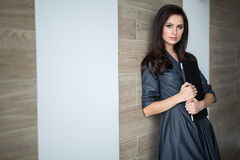 Business portrait slim pretty girl in a strict Stock Photography