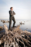 Businessman standing. Business portrait of a young man standing near the water Stock Photos