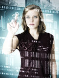 Business portrait young women in front of digital glass. Young woman in business clothes standing in front of the glass wall and think about business. the wall Stock Image