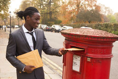 Business post. A business man sending letters Stock Photo