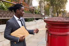 Business post. A business man sending letters Royalty Free Stock Photography