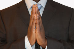 Business prayer. This is an image of a black business man praying for success. Metaphor for honesty etc Royalty Free Stock Photography