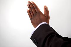 Business- Praying. This is an image of businessman with hands in a prayer posture Stock Photo