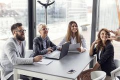 Business presentation. Business team on a morning briefing; business meeting and presentation in a modern office stock images