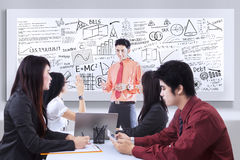 Business presentation on whiteboard Stock Images