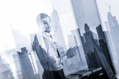 Business presentation on corporate meeting against new york city window reflections. royalty free stock photo