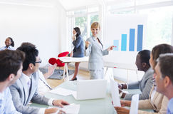 Business Presentation of a Corporate Woman to her Colleagues.  royalty free stock photography