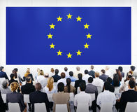 Business Presentation With Europe Union Flag. Group Of Business People Looking At The European Union Flag Stock Photos