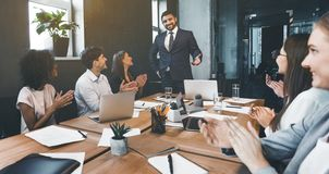 Business presentation. Group of businesspeople clapping hands stock photography