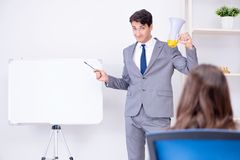 The business presentation in the office with man and woman. Business presentation in the office with men and woman Royalty Free Stock Images