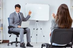 The business presentation in the office with man and woman. Business presentation in the office with men and woman Royalty Free Stock Photo