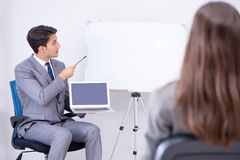 The business presentation in the office with man and woman. Business presentation in the office with men and woman Stock Photo