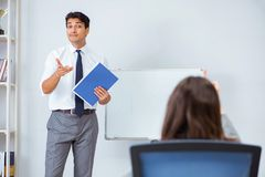 The business presentation in the office with man and woman. Business presentation in the office with men and woman Stock Photos