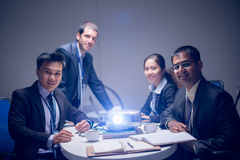Business presentation. Portrait of a business team at the company�s presentation with a projector on the foreground Stock Photography