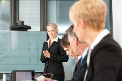 Business - presentation within a team Royalty Free Stock Photography