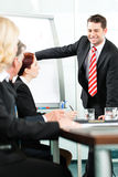 Business - presentation within a team Royalty Free Stock Photos