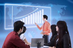 Business presentation with touchscreen chart Royalty Free Stock Images