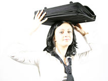 Business pressure. High key portrait of a young business woman carrying a briefcase stock photos